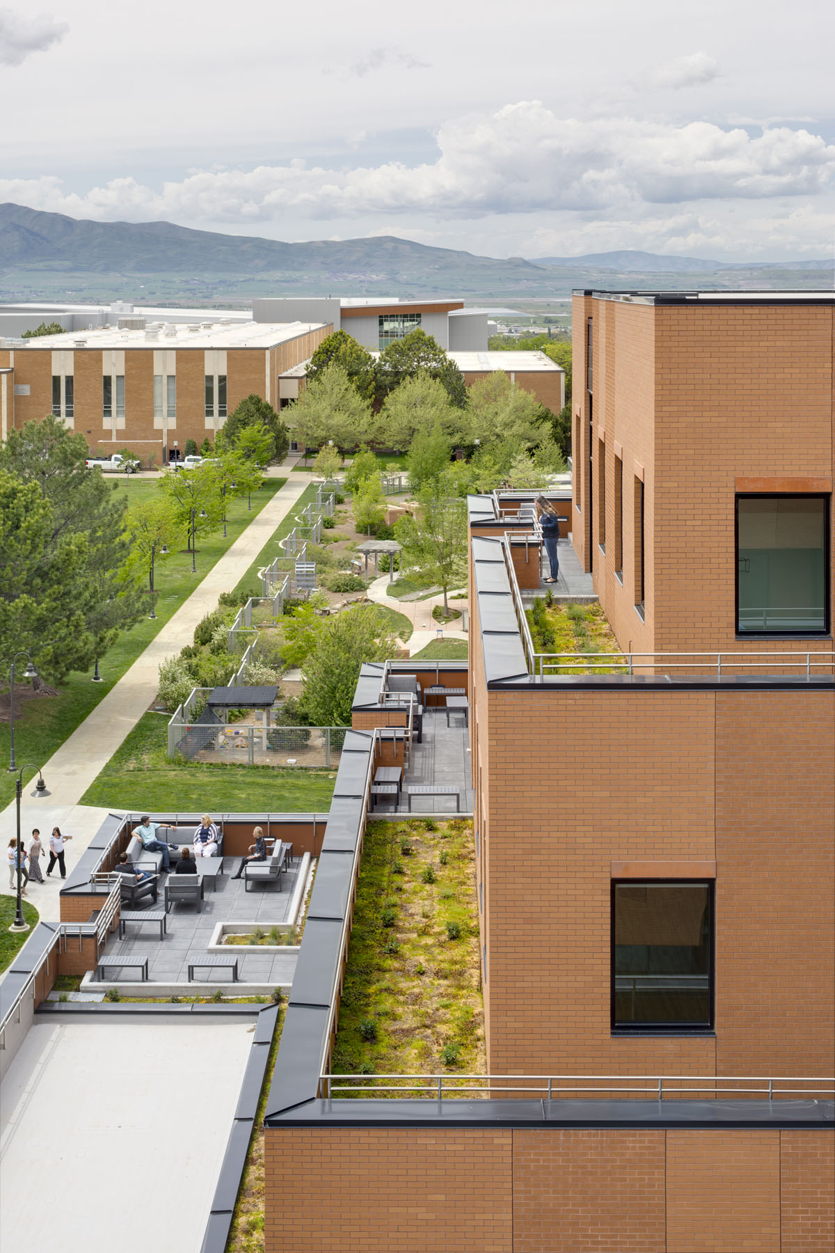 Rooftop decks with outdoor furniture and green roofs are part of the healthcare design.