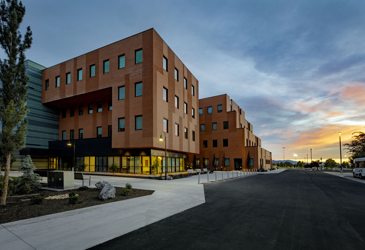 The two wings of the healthcare design building glow in the light of the setting sun.