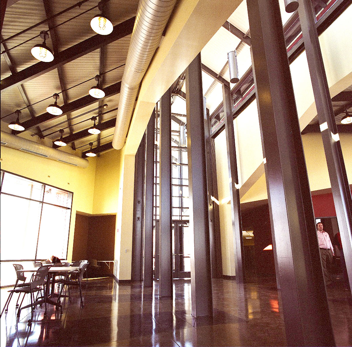 Steel beams run down the middle of the lobby inside the Agricultural Teaching and Research Facility.