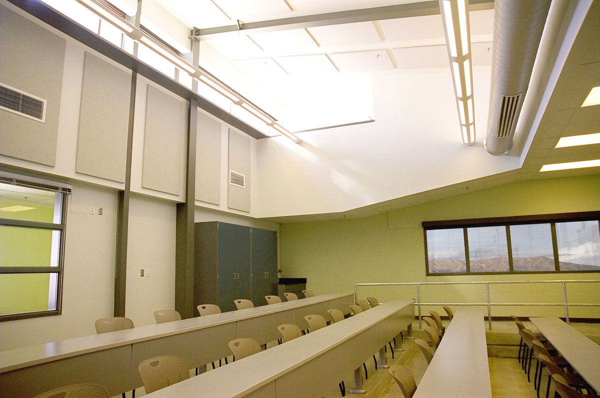 A classroom inside the Agricultural Teaching and Research Facility with graduating rows of tables and chairs.