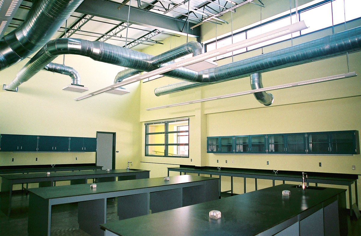 A lab classroom with black lab tables in the Agricultural Teaching and Research Center.
