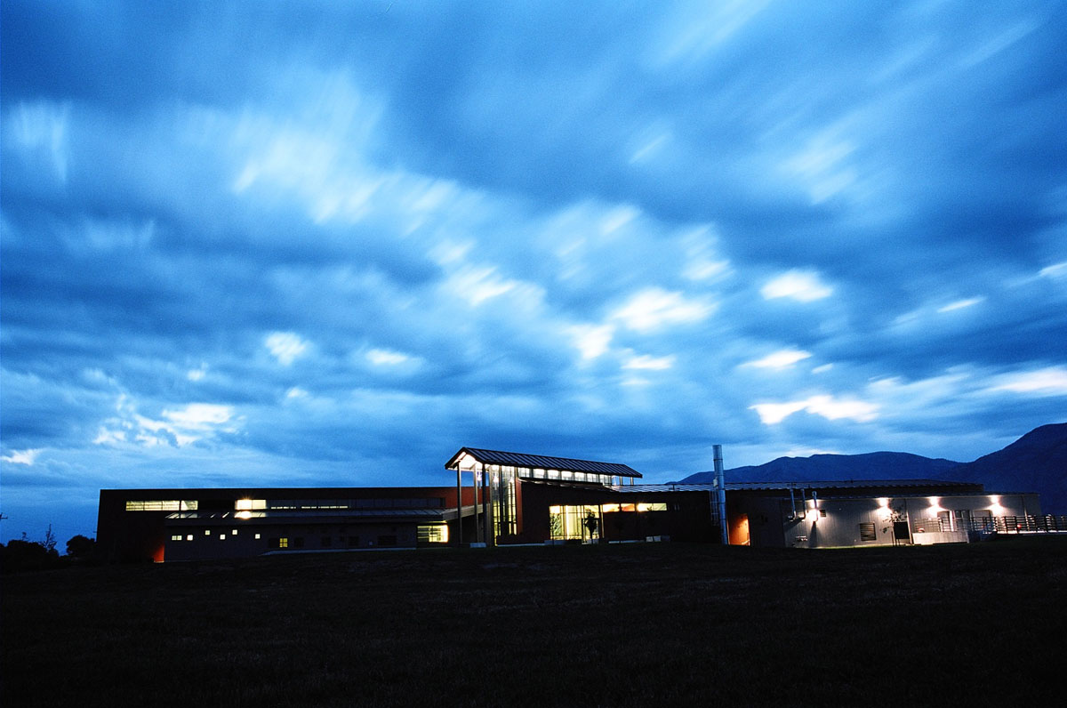 Blurry clouds rush past the Agricultural Teaching and Research Facility in the early evening.