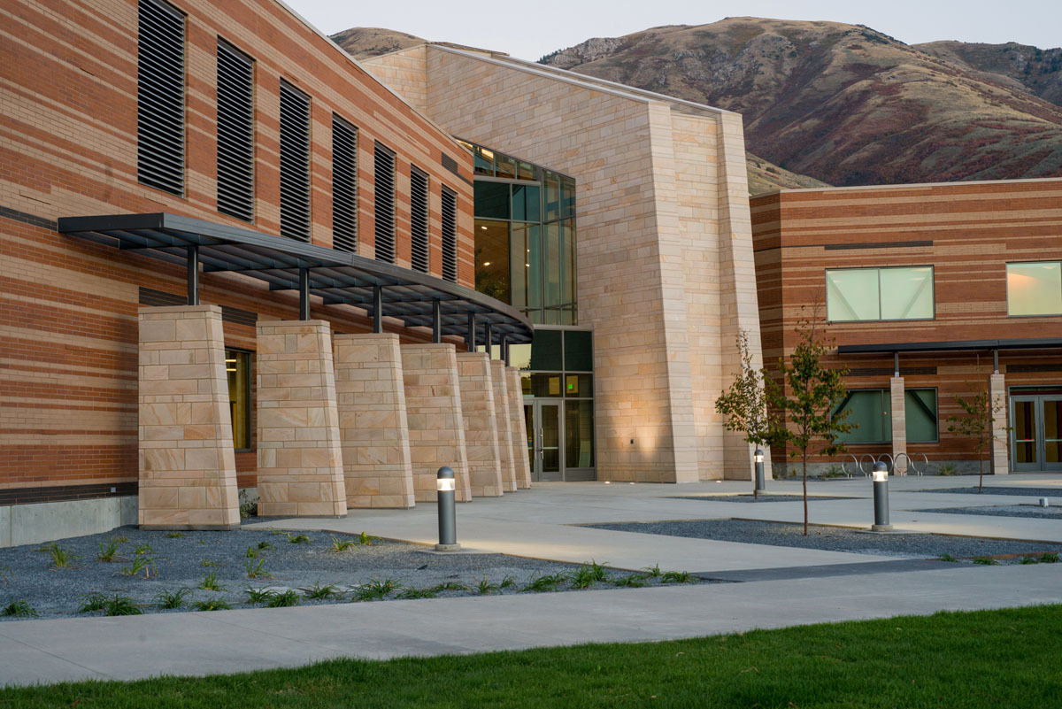 Main entrance to the classroom and student services building showing stone and brick work.