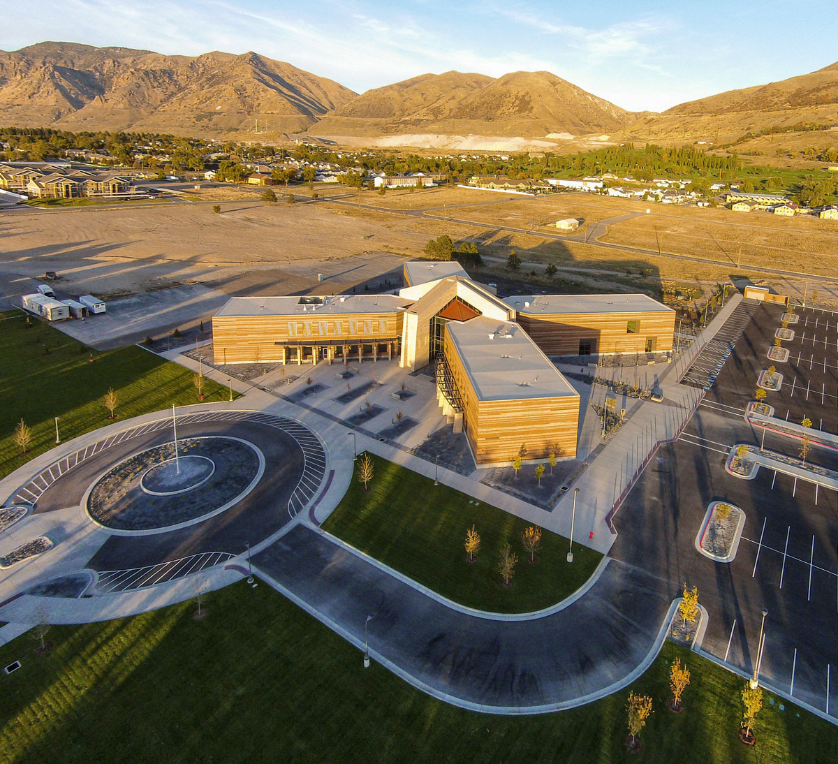 Aerial photo showing the site, roundabout, and parking lot for the classroom and student services building.