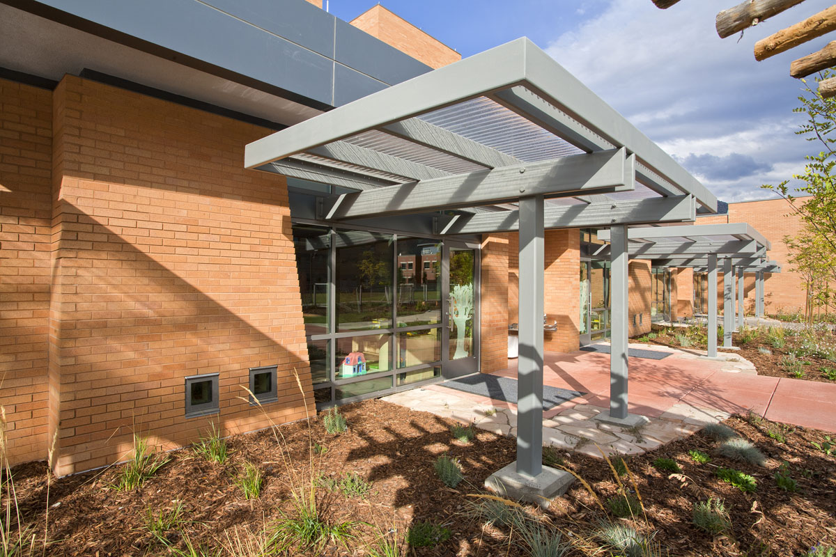 ergoal systems over exterior classroom doors provide shade and protection from the weather at the early childhood education building.