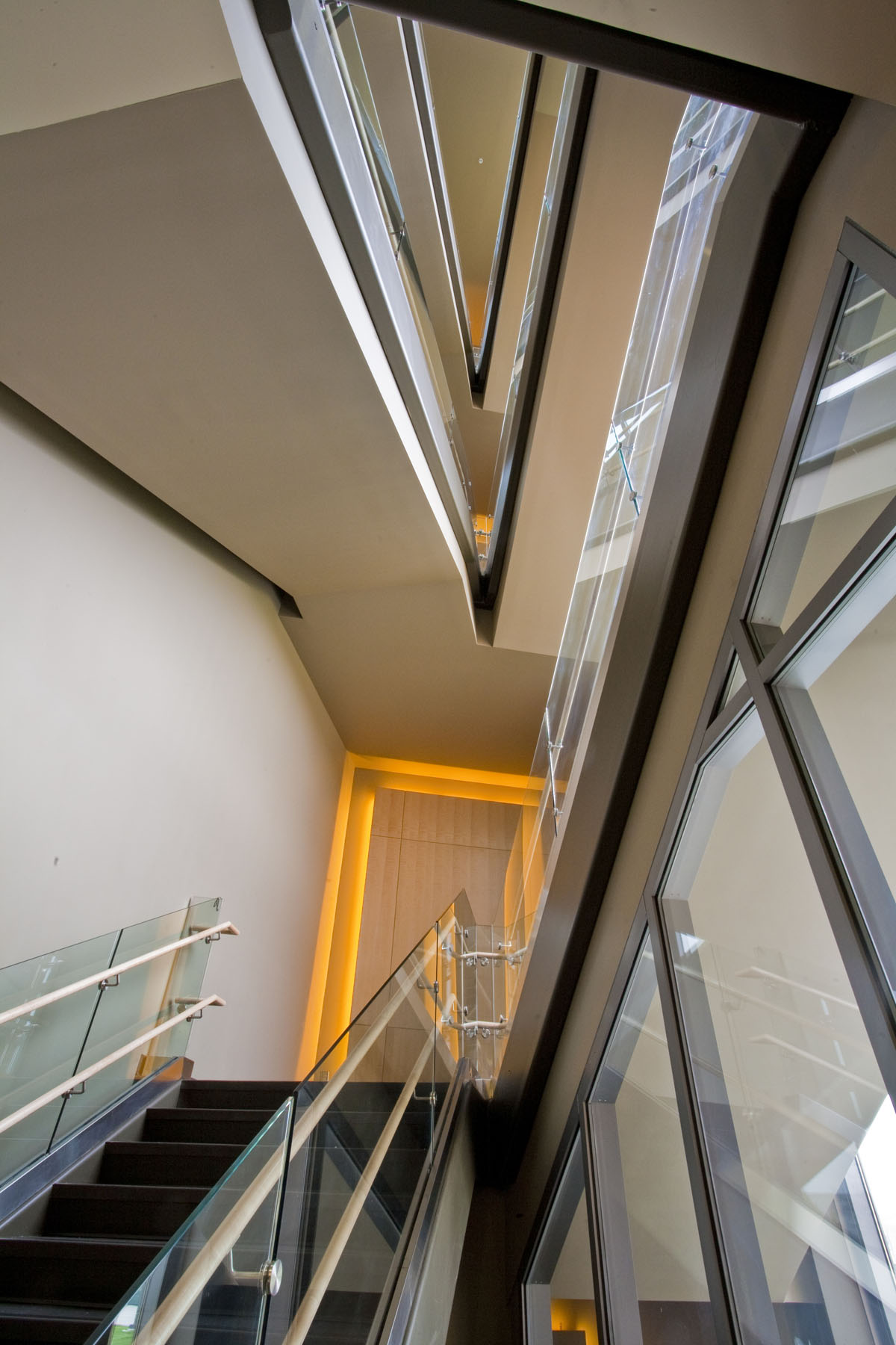 A view from the bottom of a stairway looking up to show triangular angles in the early childhood education building.