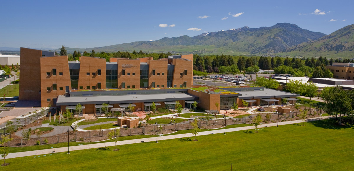 An aerial photo showing the entire early childhood education center with green roof and fenced in play area for the children.
