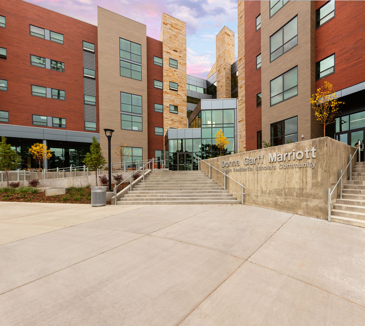 View of the glass main entrance at the honors student housing building.