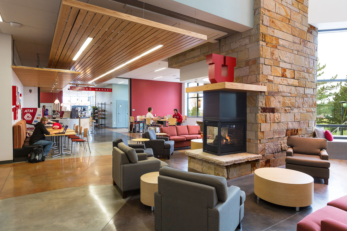 View of the cafe area from the fireplace in the lobby of the honors student housing building.