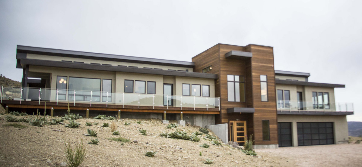 Modern home in Browns Canyon with dark wood paneling accents and wrap-around deck.