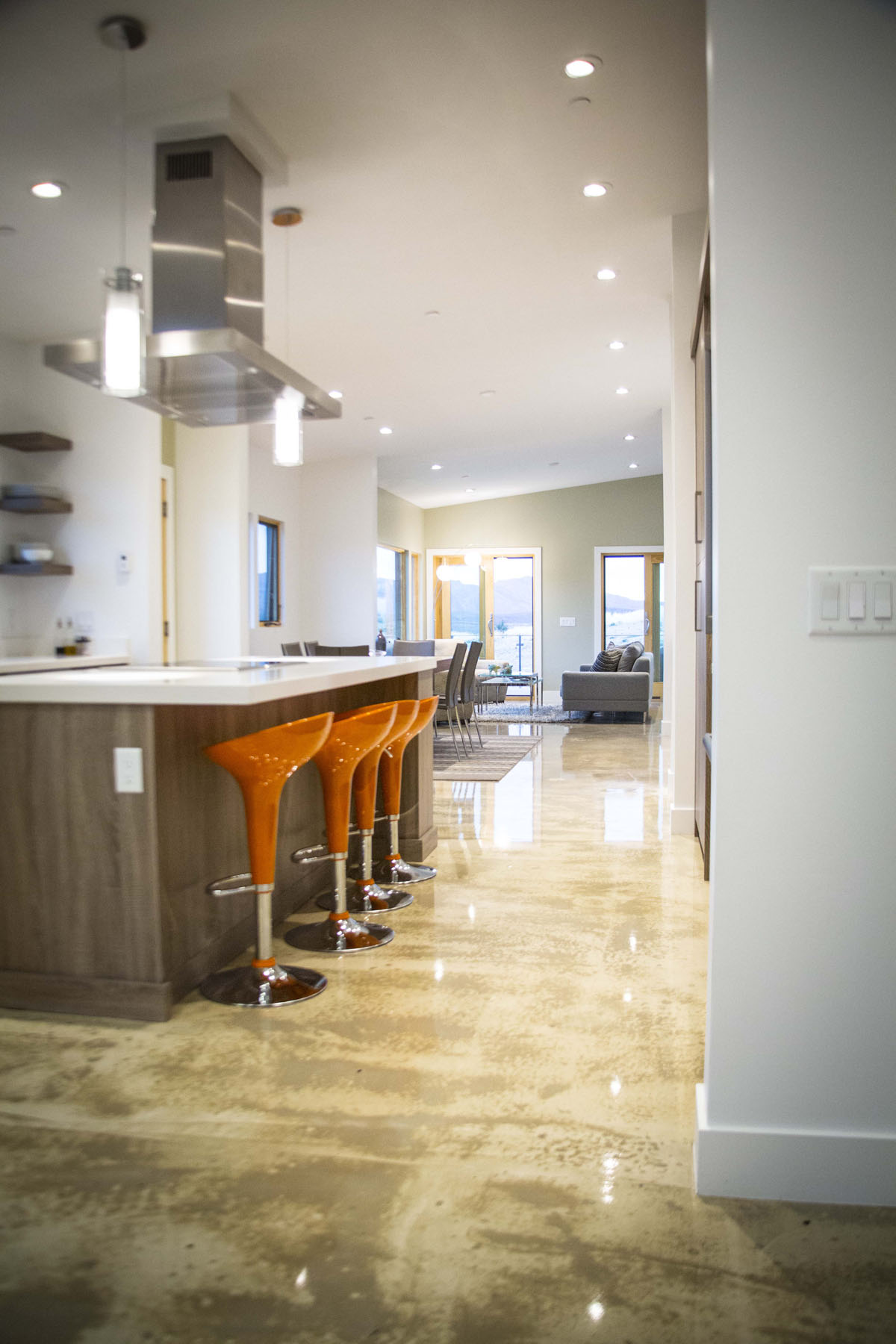 Modern home with open kitchen floor plan leading straight to a seating area beyond.