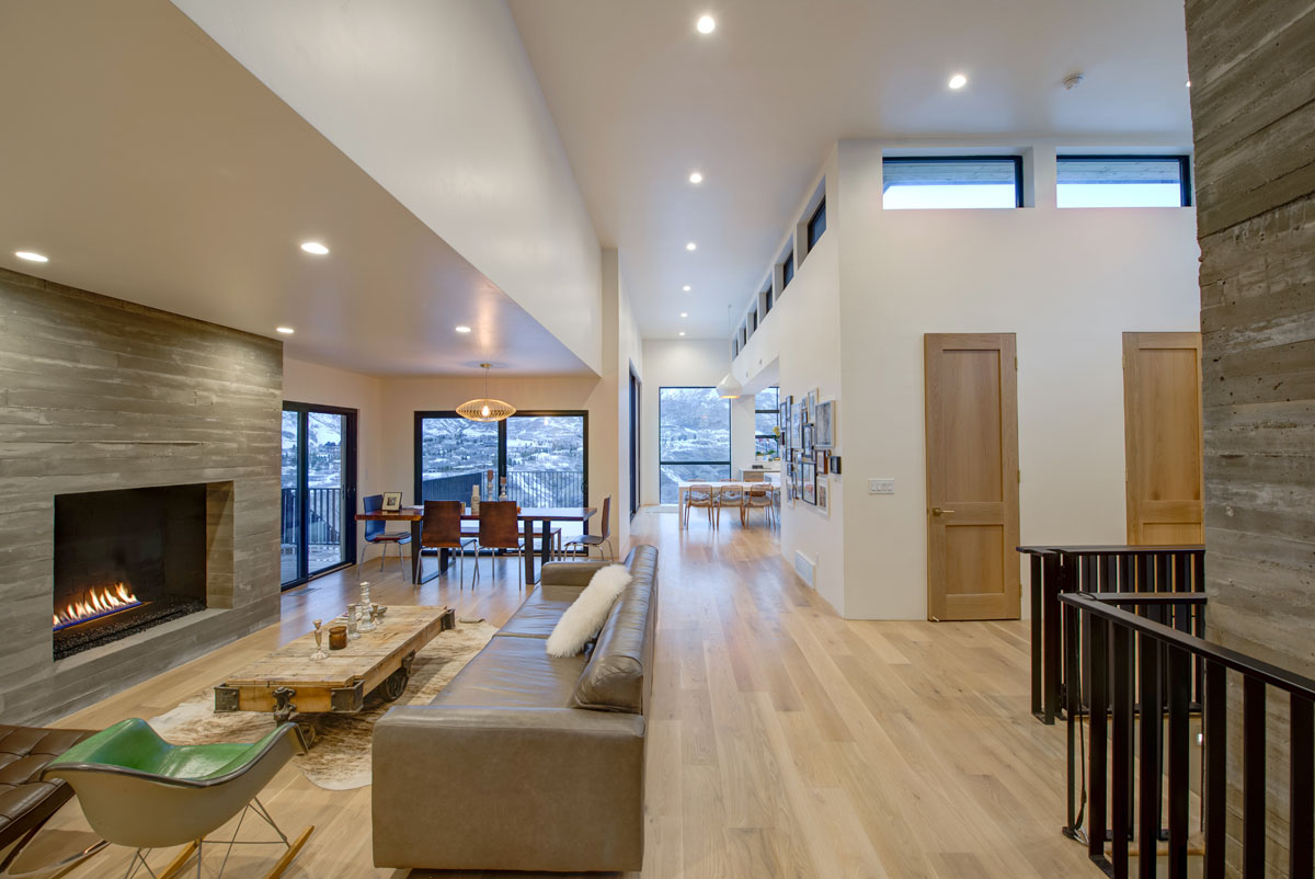 The modern residential design of this home includes an open floor plan with views from the back of the house all the way to the front.