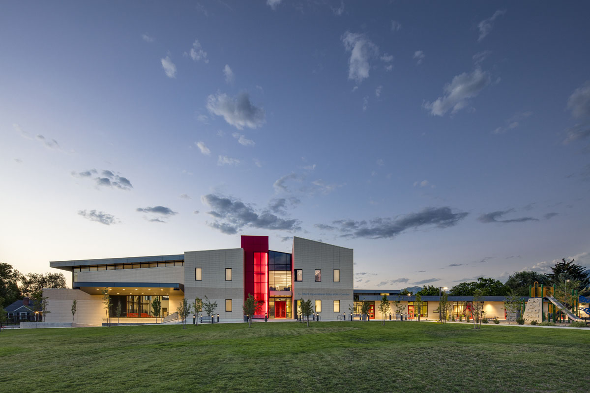 The Utah Schools for the Deaf and the Blind building with glowing red staircase.