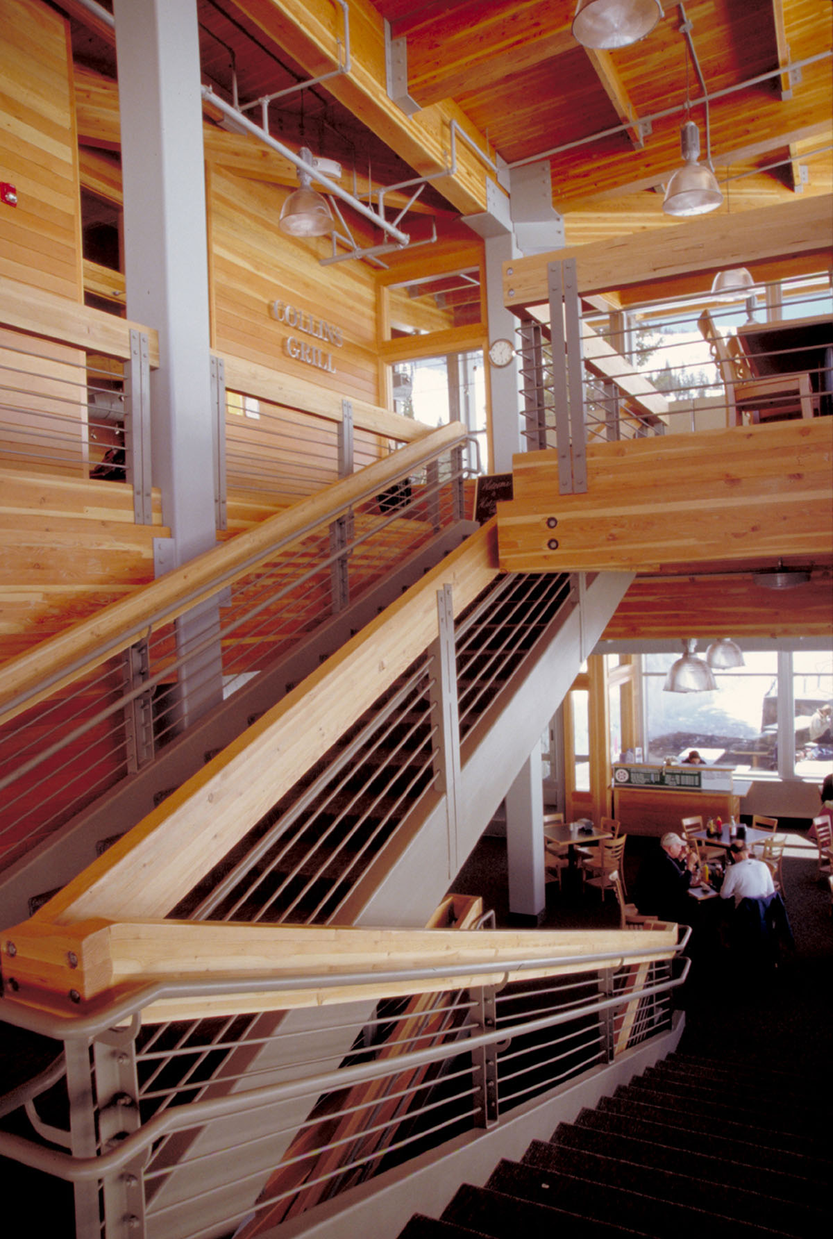 Interior of the Watson Shelter with wood paneling and metal stair rail.