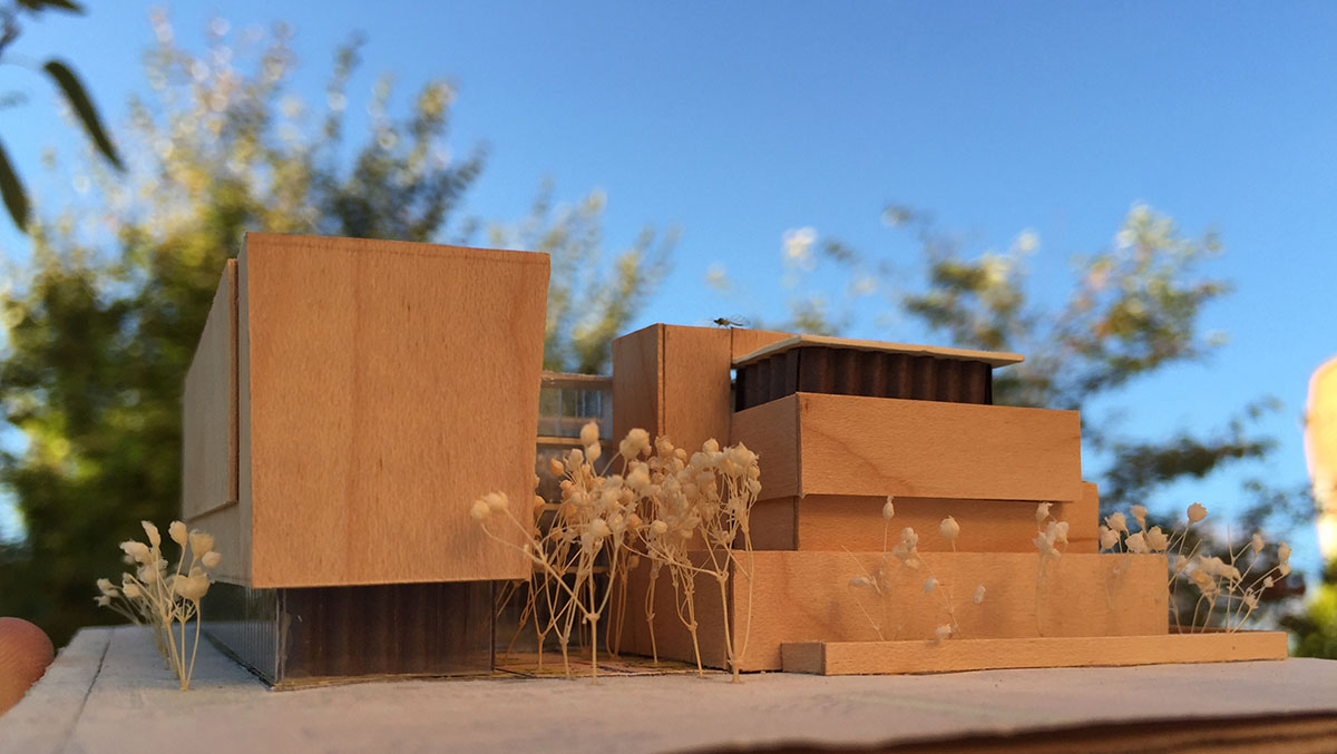 Wood scale model from side of the center for healing.