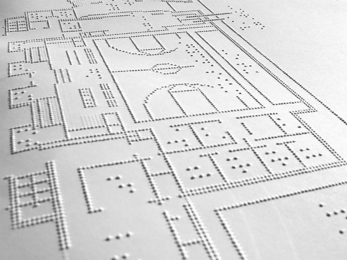 A floor plan of the building in Braille.