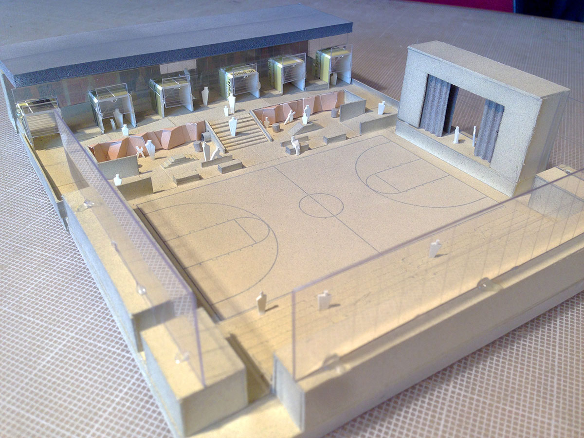 Scale model of the gymnasium showing the basketball court and indoor/outdoor stage.
