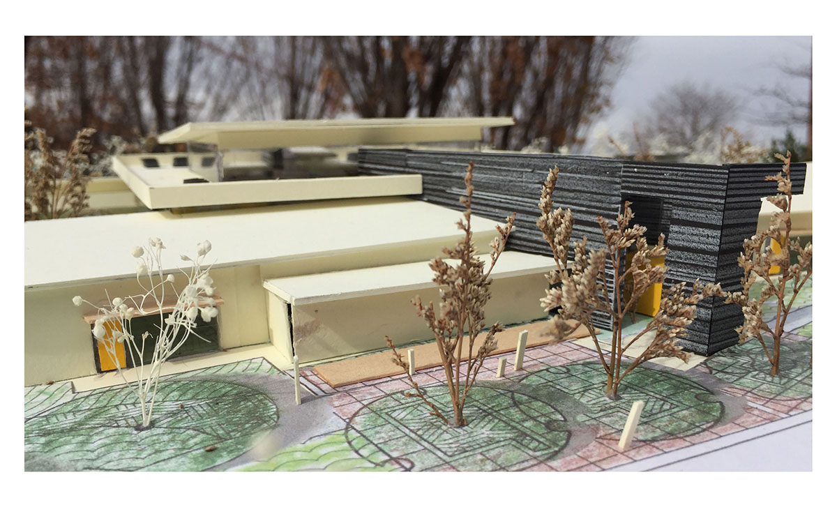 Scale model of the school with trees in the foreground.